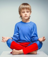 Boy in a suit in lotus position